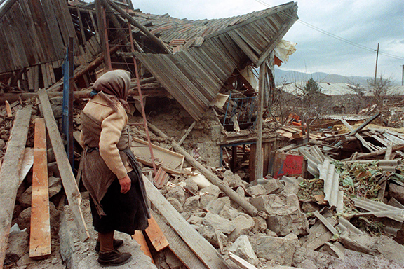 A survivor inspecting the rubble of the earthquake in Spitak