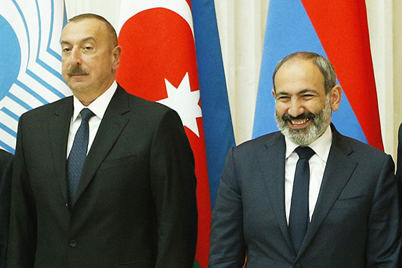 Acting Prime Minister Nikol Pashinyan (right) with Azerbaijani President Ilham Aliyev in St. Petersburg, Russia on Dec. 6