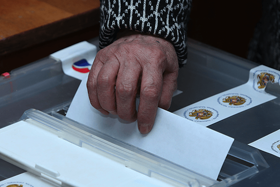 A person voting during Dec. 9 2018 election