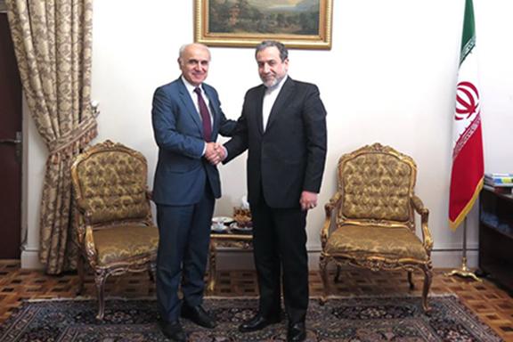 Armenian Ambassador Artashes Toumanyan (left) with Iran's Deputy Foreign Minister Abbas Araghchi in Tehran on Dec. 26