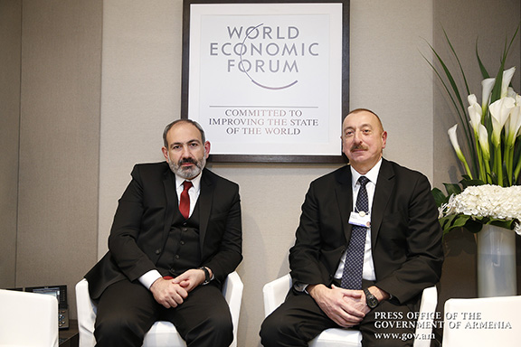 Prime Minister Nikol Pashnyan with Azerbaijani President Ilham Aliyev in Davos Switzerland on Jan. 22