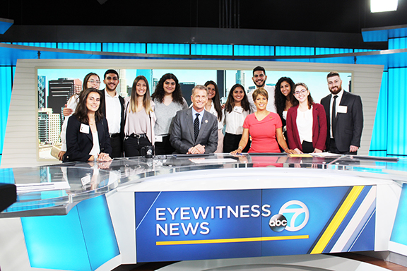 A group of interns and past participants at the ABC7 Studios.