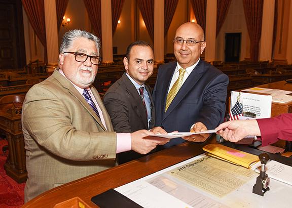 From left, Senator Anthony Portantino, Glendale Mayor Zareh Sinanyan and Armenia's Consul General to L.A. Armen Baibourtian submit SB 302
