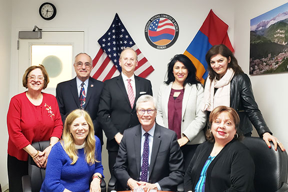 ANCA Glendale board members (standing) with GCC board members, seated from left Ann Ransford, Dr. David Viar, and Dr. Armine Hacopian
