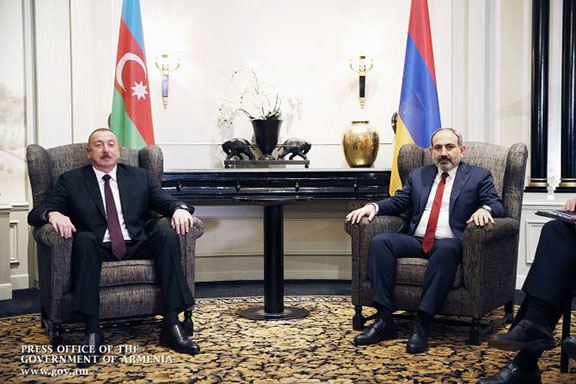 Prime Minister Nikol Pashinyan met with Azerbaijani President Ilham Aliyev (left) in Vienna on March 29