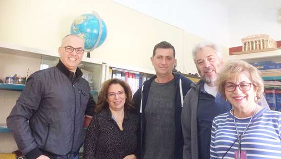 Teachers at the office Principal Ricardo Yerganian is behind the author.
