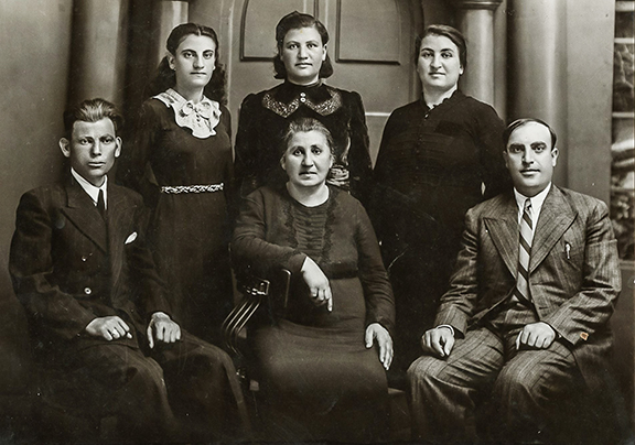 Portait of Arshaluys Yousuf (seated) with 5 of her 6 childen. Standing directly above her is author Alice Nazarian