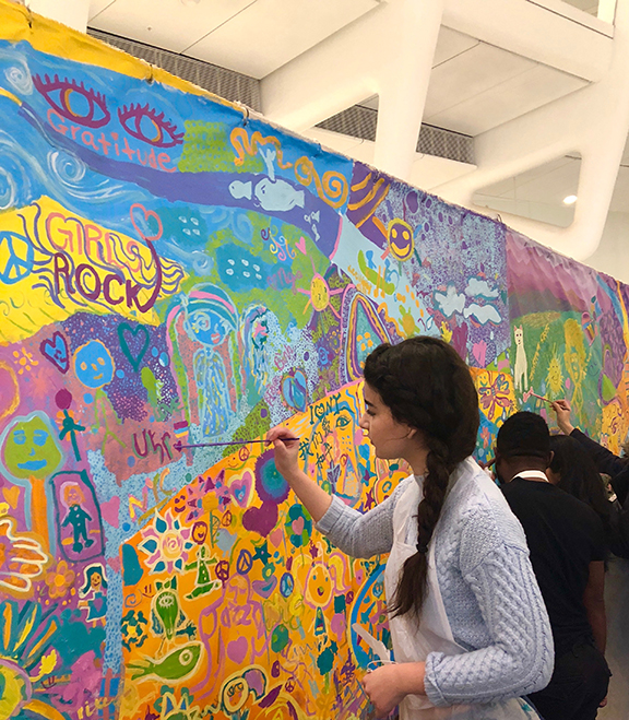 Paulette Markarian works on the mural that was displayed at UNICEF
