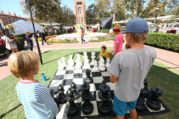 Children play chess at a past Innovate Armenia event
