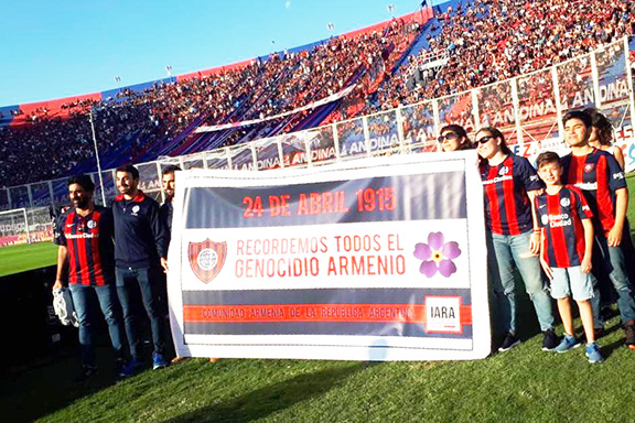 """San Lorenzo soccer team with their sign: """"Let Us All Remember the Armenian Genocide"""""""