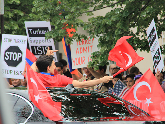 Turkish American Steering Committee supporters taunting peaceful Armenian protesters at the annual April 24th rally for justice in 2016.  This year, they have been permitted to occupy a portion of Sheridan Circle, site of the May, 2017, Erdogan-ordered attack on peaceful protesters.