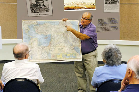 Deacon Van Der Mugrdechian displays a map showing the location of Van, Armenia