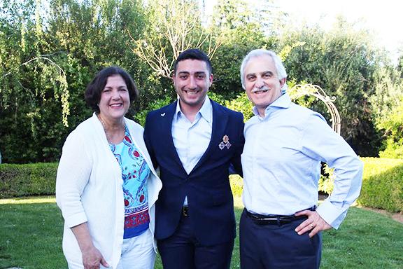 Army veteran Arman Vardanyan (center) with Dr. Shahe and Ani Yeni-Komshian
