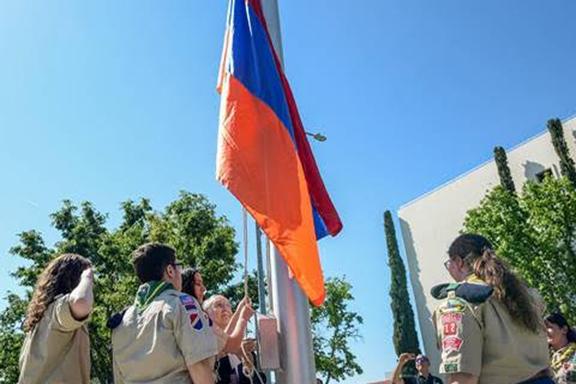 Raising of the Armenian flag by Armenian scouts