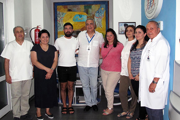 Aram (third from left) and his sister, Ani (fifth from left), with ABMDR Board members and the executive staff of the organization's Stem Cell Harvesting Center, in Yerevan