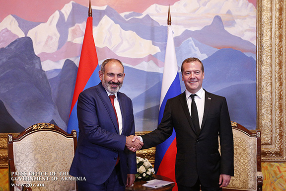 Russian Prime Minister Dmitry Medvedev (right) greets his counterpart from Armenia, Nikol Pashinyan in Kyrgystan