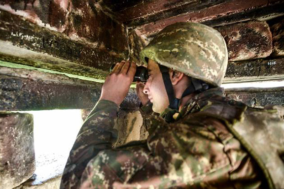 An Artsakh soldier at a military border post