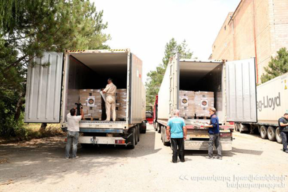 Trucks are loaded with humanitarian suppliers headed to Syria in yet another shipment from Armenia