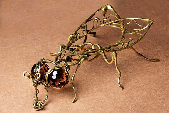 """Nur's """"The Fly,"""" made of bronze and topaz"""