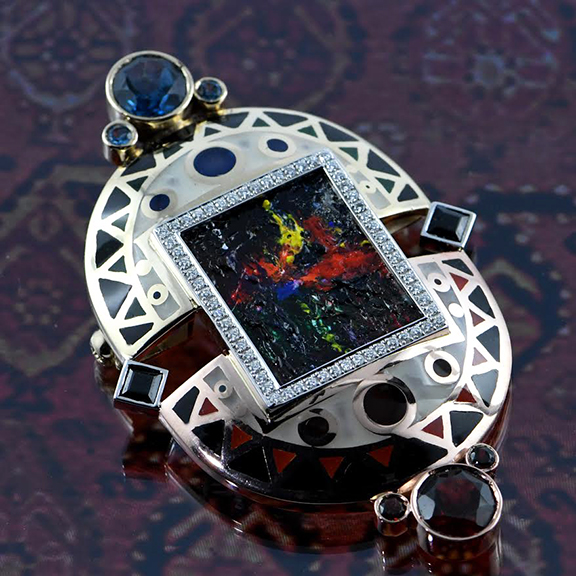 """Nur's """"Day and Night"""" brooch, made of gold, diamonds, garnet, London topaz, sapphires, enamel, oil on canvas"""