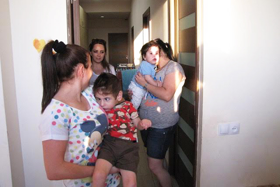 A Bari Doon physical therapist assists two mothers who have children with disabilities