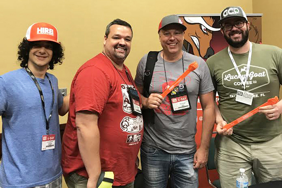 Daron (left) with individuals who playtested HIRE!