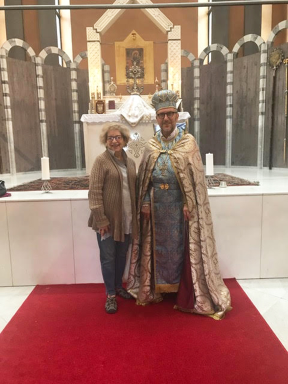 Catherine Yesayan with Father Zadik Avedikian