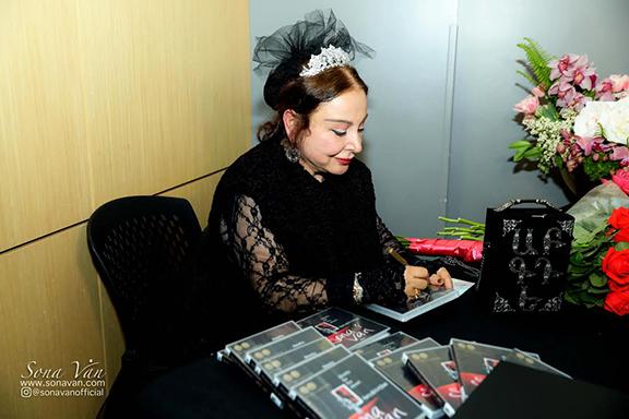 Sona Van signing copies of her audiobook
