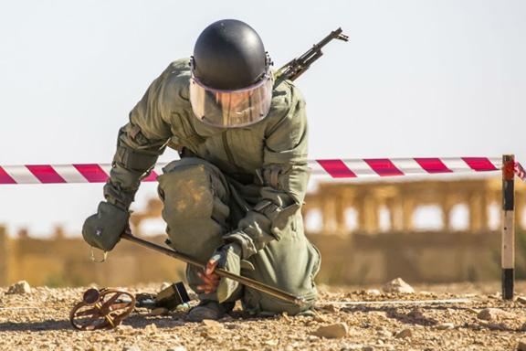 An Armenian sapper works in Syria