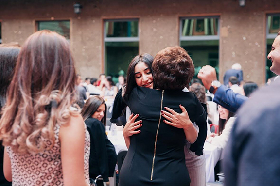 An AEF member embraces her sponsored student