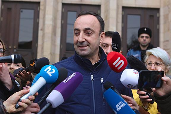Head of Armenia's Constitutional Court Hrayr Tovmasyan talks to reporters