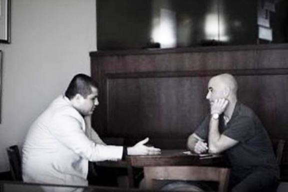 Akopyan interviewing Hall of Fame tennis player Andre Agassi