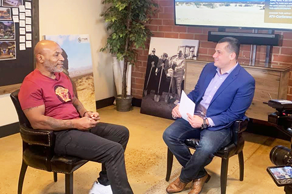 Akopyan interviewing American professional boxer Mike Tyson