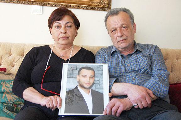 Ani and Garabet Balıkçı hold a photograph of their son Sevag (Photo: by Elsa Landard)