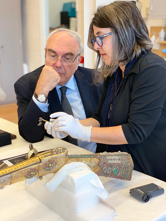 Dr. Chookaszian, the Chair of Armenian Art History and Theory at Yerevan State University (left) and Julie Lauffenburger, and Director of Conservation at the Walters Art Museum (right), amid inspections of the bejeweled gun
