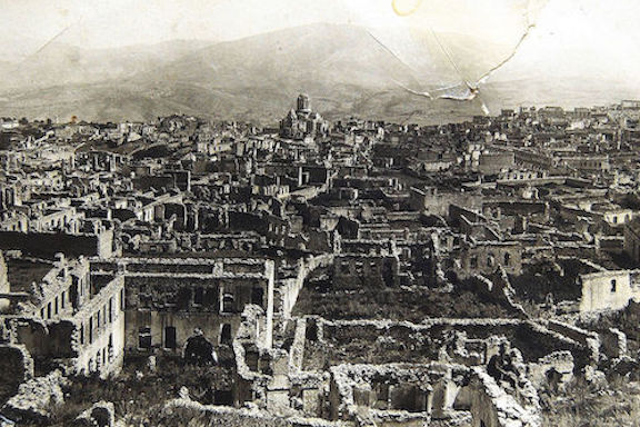 A ravaged Shushi after the Azerbaijani army destroyed the city on March 23, 1920. The Ghazantchetsots Cathedral is in the background