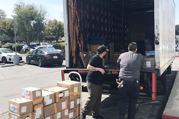 Boxes of critical supplies necessary for screening and isolation being loaded on its way to LAX air cargo for a speedy arrival to Armenia