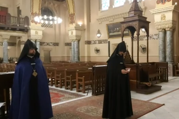 With the pews empty, Armenian religious leaders performed Palm Sunday Mass, which was broadcast on Facebook Live