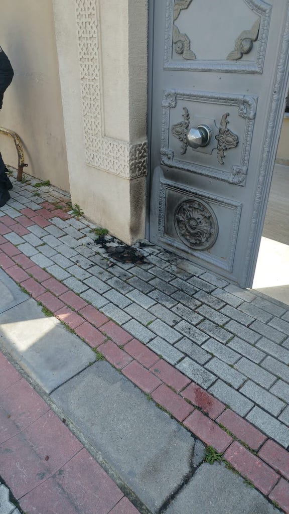 assailants set fire at the entrance of the St, Mary's Church in Istanbul