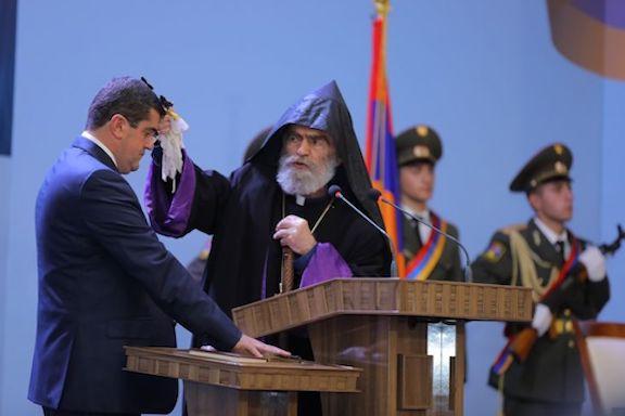 Primate of the Artsakh Diocese Archbishop Parkev Martirosyan blesses Arayik Harutyunyan on his inauguration