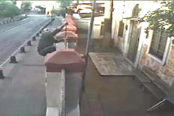 A man was caught on security camera climbing the fence of the St. Gregory the Illuminator Church in Istanbul