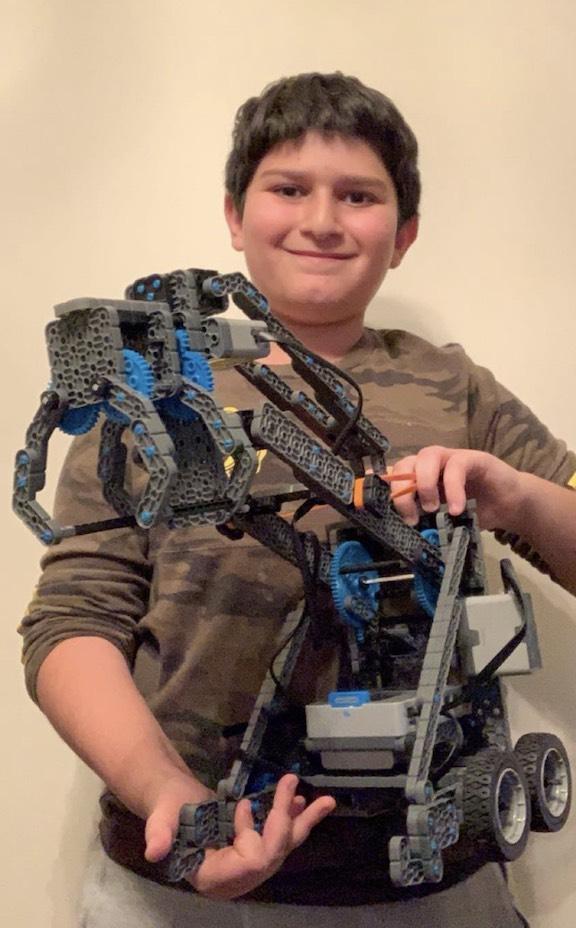 Mesrobian Distance Robotics Club member Larry Barseghian, seventh grade, with his robot.