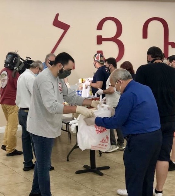 Members of the ARF Hollywood Karekin Njdeh gomideh were joined by St. Garabed Church pastor Archpriest Vicken Vassilian to prepare care packages for community members