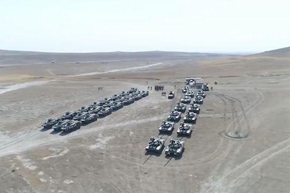 Turkish and Azerbaijan tanks and armored vehicles line a field in Azerbaijan on July 30