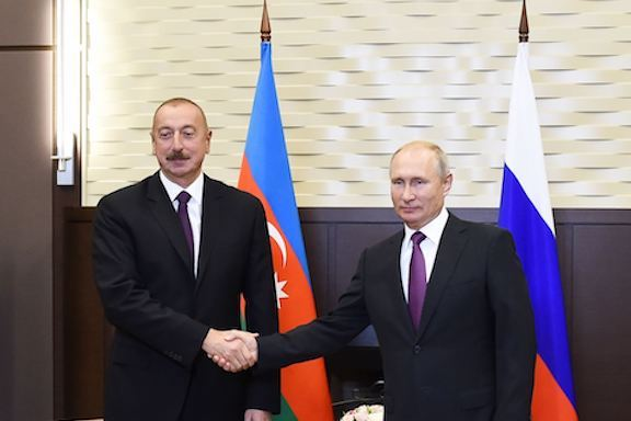 President Ilham Aliyev of Azerbaijan (left) with his Russian counterpart Vladimir Putin in Moscow in 2018
