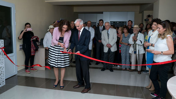 A crowd of physicians, staff and supporters witnesses the ribbon cutting for AECP's Regional Eye Clinic opening in Gyumri in 2018. This year's clinic opening will be a little different.