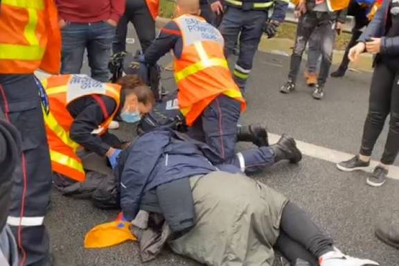 Paramedics tend to a protester who was hit in the head and lost consciousness