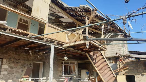 A damaged building from Azerbaijani shelling of Stepanakert