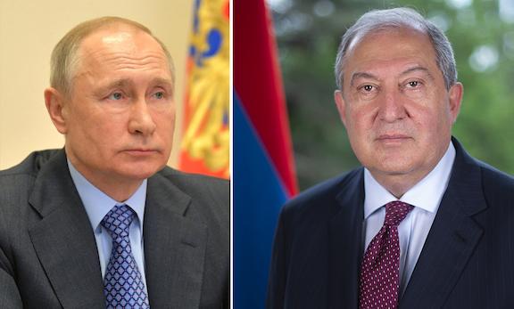 Russian President Vladimir Putin (left) and Armenia's President Armen Sarkissian