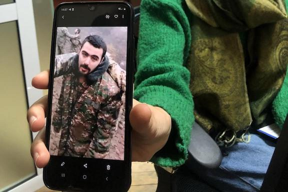 Erica Khachaturyan shows Human Rights Watch an image of her nephew Eric Khachaturyan, a prisoner of war (POW) in Azerbaijan, taken from a video in which he and other POWs are abused. Yerevan, November 2020